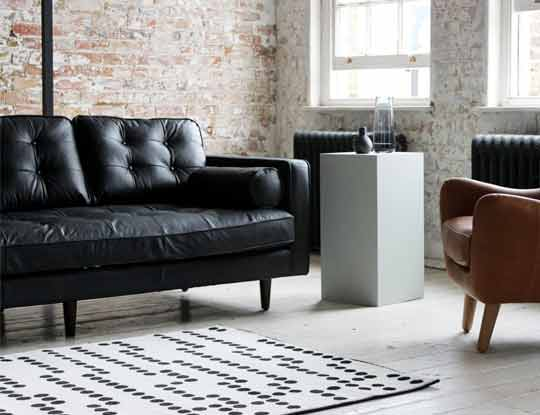 3 seater black leather sofa in room set