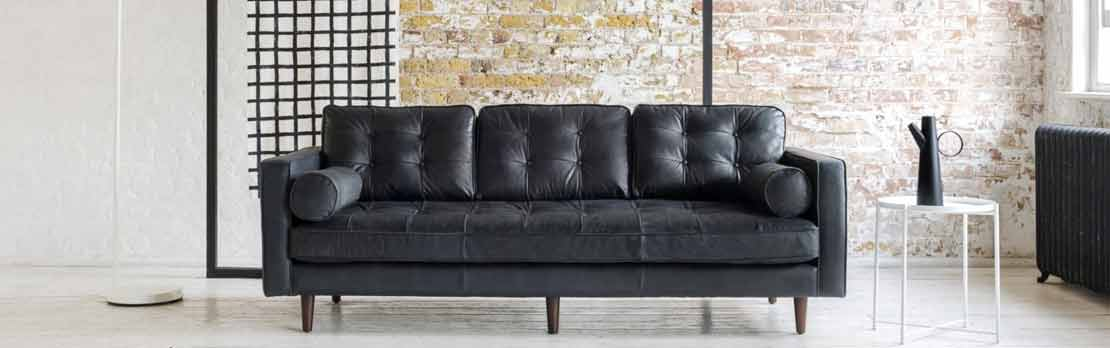 large black leather sofa in modern home
