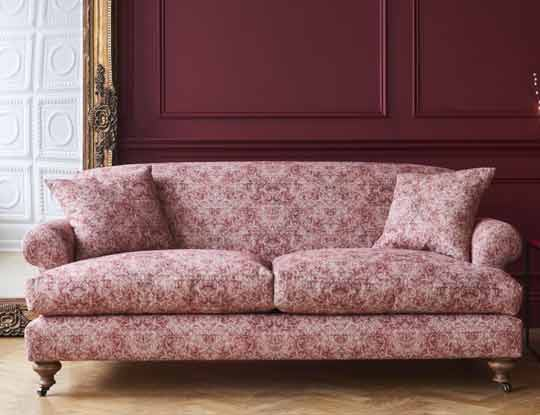red linen sofa in stately home