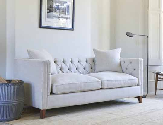 white linen chesterfield sofas
